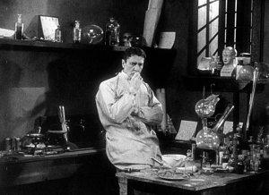 sherlock-holmes-1916-006-holmes-in-lab-pondering